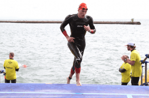 Angus Smith finishes the swimming section of a triathlon