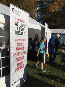 A marathon runner exits the Function Jigsaw tent after treatment at the Leicester Marathon